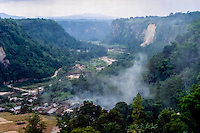 West Sumatra, Bukittinggi. Sianok canyon (Ngarai Sianok) is a steep valley (ravine) located in Bukittinggi, about 15 km long. Houses at the valley floor.