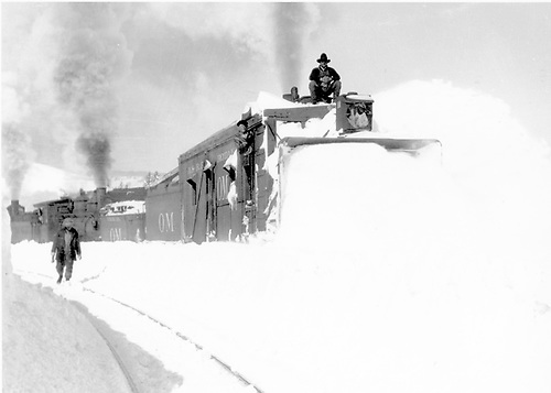 Rotary snowplow OM pushed by at least two engines clearing snow at Cumbres station.<br /> D&amp;RG  Cumbres, CO