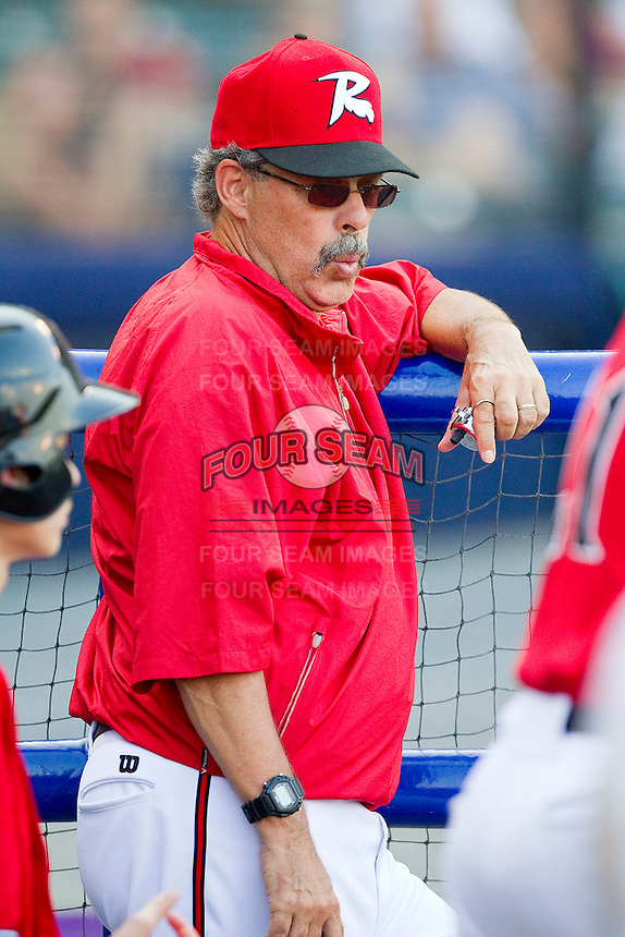 Richmond Flying Squirrels pitching coach Ross Grimsley #19 watches the action against the Harrisburg Senators in game one of a double-header at The Diamond on July 22, 2011 in Richmond, Virginia.  The Squirrels defeated the Senators 3-1.   (Brian Westerholt / Four Seam Images)