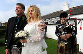 Welf and Irene Brandes, serenaded on the pipes by Pipe Major Alan Marshall, after their marriage at the Old Blacksmiths Shop at Gretna Green. Now living near Hanover, Germany, Irene is originally from Edinburgh - 10.10.10 - picture by Donald MacLeod - mobile 07702 319 738 - clanmacleod@btinternet.com - www.donald-macleod.com