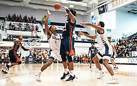 WASHINGTON, DC - NOVEMBER 16: Justin Williams #4 of George Washington defends against Mohamed Camara #14 of Morgan State during a game between Morgan State University and George Washington University at The Smith Center on November 16, 2019 in Washington, DC.