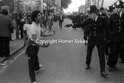 National Front march Lewisham, South London England 1977. Police confront a black youth. The police are protecting the NF from left wings demonstrators protesting against their march.<br />