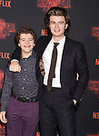 WESTWOOD, CA - OCTOBER 26: Actors Gaten Matarazzo (L) and Joe Keery arrive at the Premiere Of Netflix's 'Stranger Things' Season 2 at Regency Westwood Village Theatre on October 26, 2017 in Los Angeles, California.