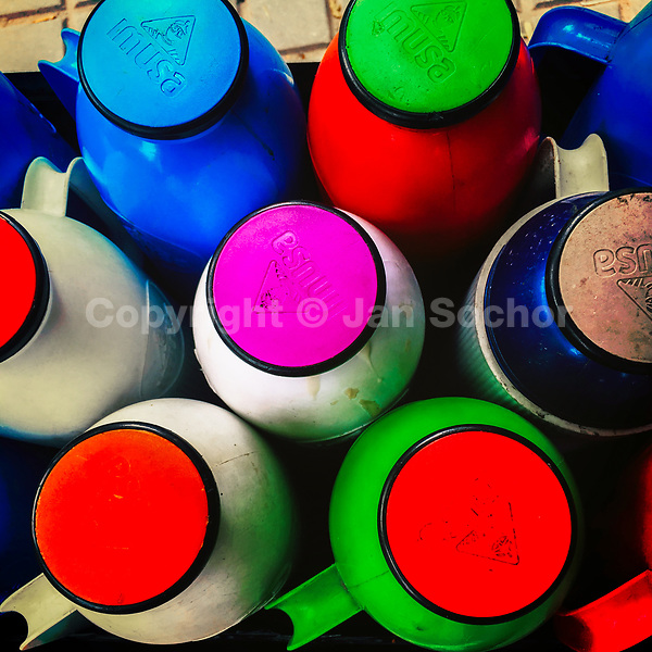 Plastic vacuum flasks, filled with black coffee called 'tinto', are seen in a street vendor's cart in Bogotá, Colombia, 26 September 2019.