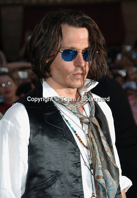 Johnny Depp   arriving at the PIRATES of the CARIBBEAN, at Word End Premiere at Disneyland In Los Angeles. <br /> <br /> headshot<br /> eye contact