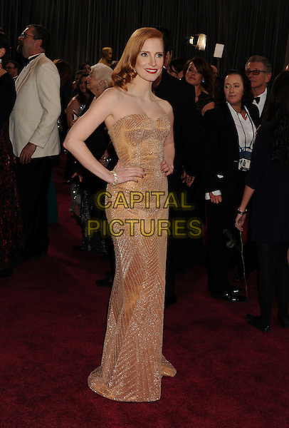 Jessica Chastain (wearing Armani Prive).85th Annual Academy Awards held at the Dolby Theatre at Hollywood & Highland Center, Hollywood, California, USA..February 24th, 2013.oscars full length blush strapless dress gown sweetheart neckline gold sparkly hands on hips  .CAP/ROT/TM.©Tony Michaels/Roth Stock/Capital Pictures