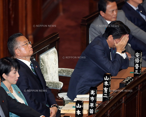 November 10, 2016, Tokyo, Japan - Japanese Agriculture Minister Yuji Yamamoto (L) looks up while Prime Minister Shinzo Abe (R) covers his face with his hands as they wait to vote for Yamamoto's no-confidence motion at the Lower House plenary session at the National Diet in Tokyo on Thursday, November 10, 2016. The no-confidence motion brought by opposition parties for Yamamoto's verbal gaffes was voted down by ruling parties.  (Photo by Yoshio Tsunoda/AFLO) LWX -ytd-