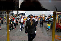 ISTANBUL - MAY 26, 2007:  A man walks from the ferry terminal to the Tram in Istanbul, Turkey. Photo by Landon Nordeman.