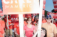 Supporters of Republican presidential candidate Carly Fiorina gather before marching in the Labor Day parade in Milford, New Hampshire. Republican candidates John Kasich, Carly Fiorina, and Lindsey Graham, and Democratic candidate Bernie Sanders marched in the parade.