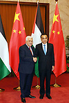 Palestinian President Mahmoud Abbas shakes hands with Chinese Prime Minister Li Keqiang before a meeting, in Beijing, China, on July 19, 2017. Abbas is on an official visit to China from July 17-20. Photo by Thaer Ganaim