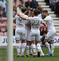 Leeds United's Patrick Bamfordn (left) celebrates scoring the opening goal <br /> <br /> Photographer Stephen White/CameraSport<br /> <br /> The EFL Sky Bet Championship - Wigan Athletic v Leeds United - Saturday 17th August 2019 - DW Stadium - Wigan<br /> <br /> World Copyright © 2019 CameraSport. All rights reserved. 43 Linden Ave. Countesthorpe. Leicester. England. LE8 5PG - Tel: +44 (0) 116 277 4147 - admin@camerasport.com - www.camerasport.com