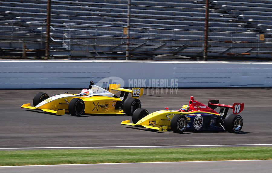 May 28, 2010; Indianapolis, IN, USA; Indy Light Series driver Adrian Campos Jr. (22) races alongside Gustavo Yacaman (10) during the Freedom 100 at the Indianapolis Motor Speedway. Mandatory Credit: Mark J. Rebilas-