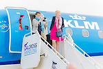 Inverness Airport welcomed KLM&rsquo;s Inaugural flight from Amsterdam. To celebrate the new route, the first flight from Schiphol, Amsterdam was greeted by a water cannon salute upon arrival.  On board were Barry ter Voert, Senior Vice President, Air France KLM European Markets and Wilco Swejen, Director for Aviation Marketing, Schipol Airport.  Provost Helen Carmichael, The Highland Council, Inglis Lyon, Managing Director of Highlands and Islands Aiports and Drew Hendry MP (Inverness, Nairn, Badenoch and Strathspey) met the delegation, officially welcoming the group to the Highlands.   <br /> <br /> Pictured: Passengers disembark from KLM flight KL0929 (Embraer ERJ-175STD) as it arrives at Inverness Dalcross airport.<br /> <br /> Image by: Malcolm McCurrach<br /> Tue, 17, May, 2016 |  &copy; Malcolm McCurrach 2016 |  New Wave Images UK | Insertion and use fees apply |  All rights Reserved. picturedesk@nwimages.co.uk | www.nwimages.co.uk | 07743 719366 <br /> <br /> Event Photographer | Corporate Photographer | Editorial Photographer | Music Photographer