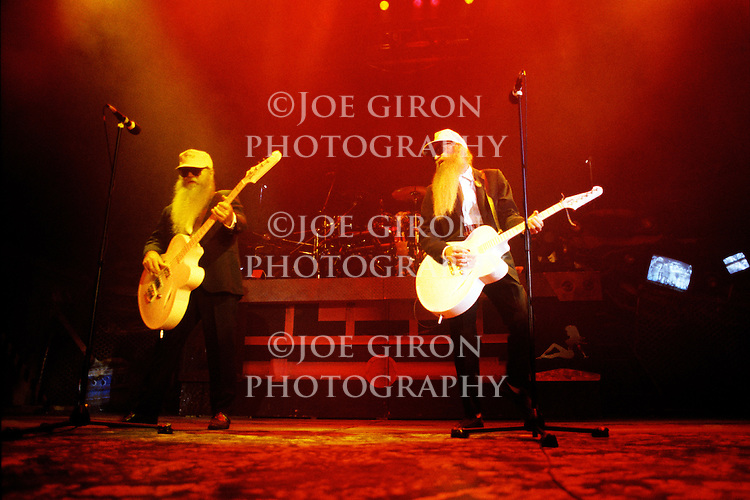 Various live photographs of the rock band, ZZ Top
