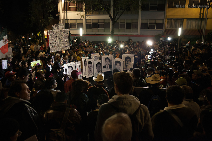 Demonstrators, along with the Parents and relatives of the 43 missing students of the Ayotzinapa Teacher Training College Raul Isidro Burgos during a New Year's Eve protest near Los Pinos presidential residence in Mexico City, Mexico on December 31, 2014. The relatives of the 43 missing students do not believe the official line that the young men are all dead. The 43 students went missing on Sept. 26 after confrontations in which police gunfire killed six people and wounded at least 25 in Iguala, in Guerrero state. Alexander Mora Venancio, one of the 43 Ayotzinapa's missing students, has been identified and confirmed dead by authorities. Many are demanding justice and that the search for the 42 missing students continue until there is concrete evidence to the contrary. Mexico – officially - lists more than 20 thousand people as having gone missing since the start of the country's drug war in 2006, and the search for the missing students has turned up other, unrelated mass graves. (Photo by Bénédicte Desrus)