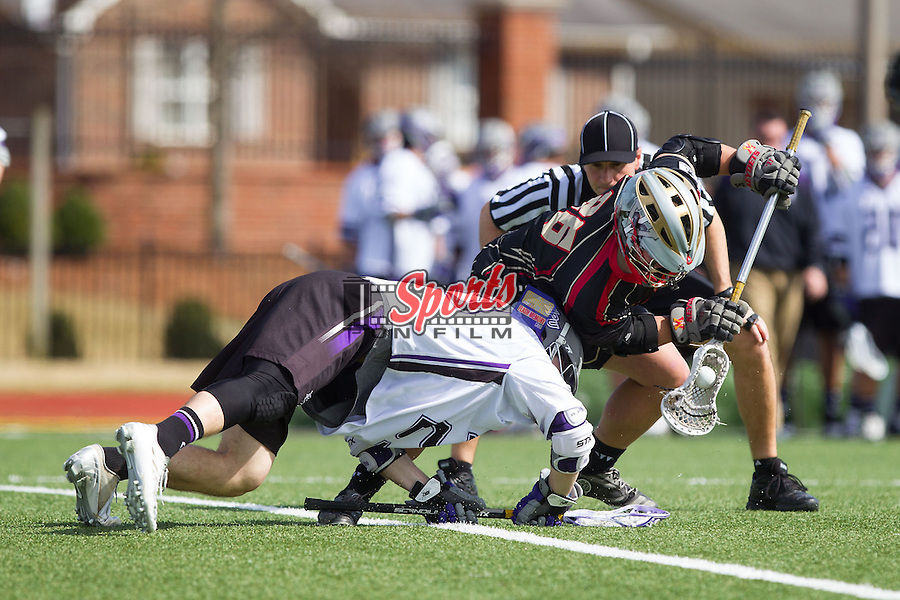 Mitch Wilson (26) of the VMI Keydets wins a face-off against Jamie Piluso (25) of the High Point Panthers at Vert Track, Soccer & Lacrosse Stadium on March 8, 2014 in High Point, North Carolina.  The Panthers defeated the Keydets 9-8.   (Brian Westerholt/Sports On Film)