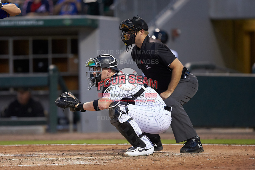 Charlotte Knights catcher Zack Collins (8) sets a target as home plate umpire Brian Peterson looks on during the game against the Durham Bulls at BB&T BallPark on July 31, 2019 in Charlotte, North Carolina. The Knights defeated the Bulls 9-6. (Brian Westerholt/Four Seam Images)