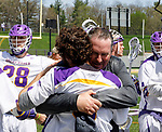 Albany coach Scott Marr gives his goalkeeper  (JD Colarusso (#9)  a celebratory hug after the game.  UAlbany Lacrosse defeats Vermont 14-4  in the American East Conference Championship game at Casey Stadium, May 5.