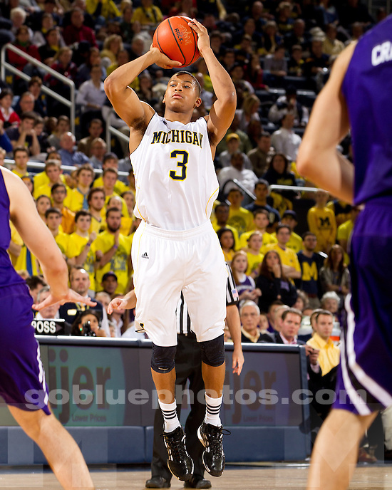 The University of Michigan men's basketball team defeated Northwestern in overtime, 66-64, at Crisler Arena in Ann Arbor, Mich., on January 11, 2012.
