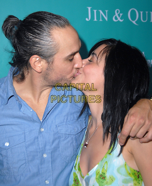 ALEX QUINN & HOST SONA.2008 ALMA Awards After-Party held at Mood Supperclub, Hollywood, California, USA..August 17th, 2008.headshot portrait blue shirt kiss kissing profile ponytail stubble facial hair .CAP/ADM/FS.©Faye Sadou/AdMedia/Capital Pictures.