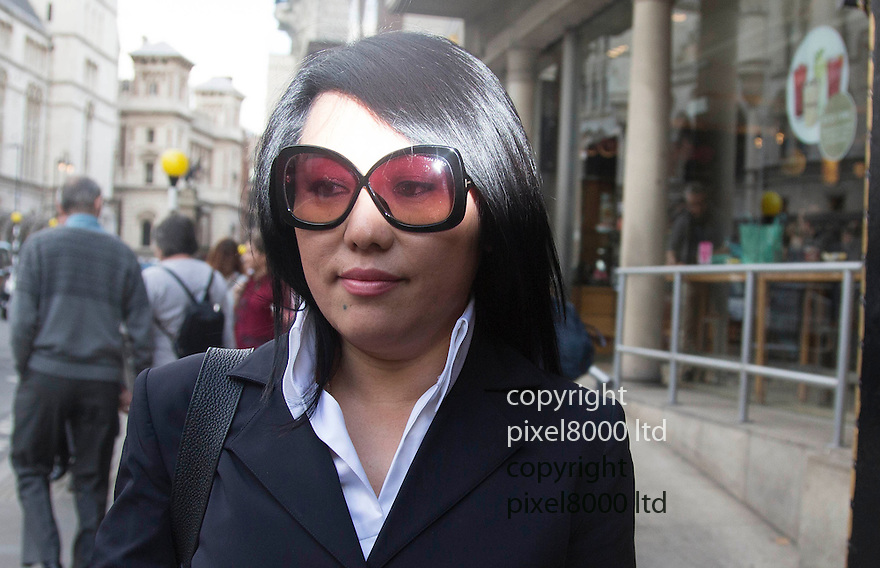 pic shows: Cheng Yin Sun  (black dress)  - also known as &quot;Kelly&quot;  leaves at court with Phil Ivey\<br /> <br /> <br /> <br /> World's number one poker star Phil Ivey arrives at the High Court in London today 2.10.14<br /> He arrived with his legal team carrying bundles of papers in his case against Crockfords casino in Mayfair, London which is owned by Gentings.<br /> <br /> The high stakes gambler who is suing Britain&rsquo;s oldest gaming club for withholding his &pound;7.3million payout<br /> They claim he was &quot;edge counting&quot;<br /> <br /> He arrived with two women of Asian appearance who may be part of his legal team or involved in the case.<br /> <br /> <br /> <br /> <br /> <br /> <br /> Pic by Gavin Rodgers/Pixel 8000 Ltd