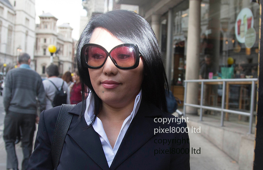 """pic shows: Cheng Yin Sun  (black dress)  - also known as """"Kelly""""  leaves at court with Phil Ivey\<br /> <br /> <br /> <br /> World's number one poker star Phil Ivey arrives at the High Court in London today 2.10.14<br /> He arrived with his legal team carrying bundles of papers in his case against Crockfords casino in Mayfair, London which is owned by Gentings.<br /> <br /> The high stakes gambler who is suing Britain's oldest gaming club for withholding his £7.3million payout<br /> They claim he was """"edge counting""""<br /> <br /> He arrived with two women of Asian appearance who may be part of his legal team or involved in the case.<br /> <br /> <br /> <br /> <br /> <br /> <br /> Pic by Gavin Rodgers/Pixel 8000 Ltd"""