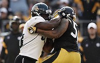 PITTSBURGH, PA - OCTOBER 16:  Greg Jones #33 of the Jacksonville Jaguars fights with LaMarr Woodley #56 of the Pittsburgh Steelers during the game on October 16, 2011 at Heinz Field in Pittsburgh, Pennsylvania.  (Photo by Jared Wickerham/Getty Images)