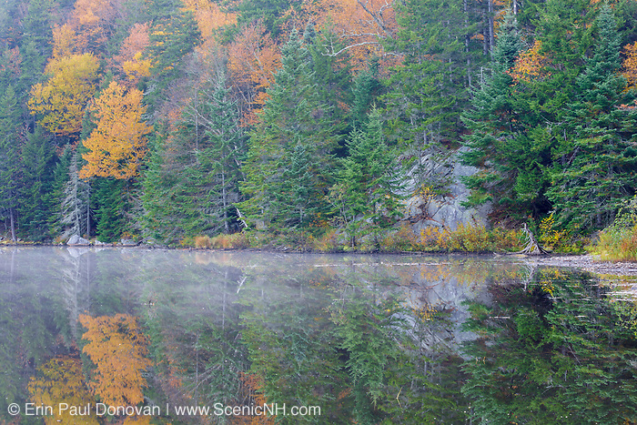 Saco Lake in Carroll, New Hampshire during the autumn months. A hiking trail goes around this scenic roadside lake.