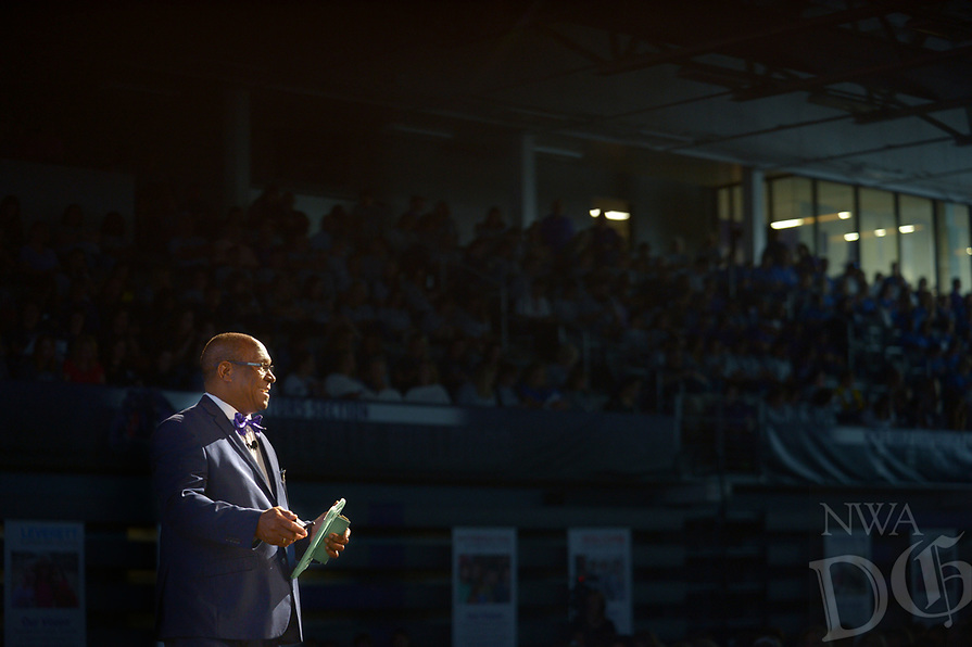 NWA Democrat-Gazette/ANDY SHUPE<br /> John L Colbert, superintendent of Fayetteville Public School, speaks to teachers, staff and administrators Friday, Aug. 10, 2018, during Fayetteville Public Schools annual Convocation ceremony in Bulldog Arena on the Fayetteville High School campus. The event, which features performances by a combined choir and the high school band as well as awards and presentations, serves as a kickoff to the school year which begins Monday.