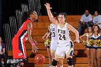 25 February 2012:  FIU guard Carmen Miloglav (24) defends South Alabama guard Mansa El (33) in the second half as the FIU Golden Panthers defeated the University of South Alabama Jaguars, 58-55 (OT), at the U.S. Century Bank Arena in Miami, Florida.