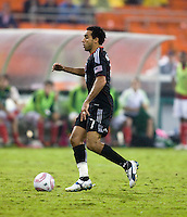 Dwayne De Rosario (7) of D.C. United  carries the ball upfield during the game at RFK Stadium in Washington, D.C. D.C. United tied the Portland Timbers, 1-1.