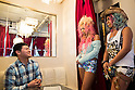A man talks with members of staff of the Ganguro Cafe &amp; Bar in the Shibuya shopping area on September 4, 2015. <br /> <br /> Ganguro is an alternative Japanese fashion trend which started in the mid-1990s where young women, rebelling against the traditional idea of Japanese beauty, wore colorful make-up and clothes and had dark-skin.<br /> <br /> 10 Ganguro fashion girls work in the new bar, which offers original Ganguro Balls (fried takoyaki style sausage balls in black squid ink batter) on its menu. Ganguro Caf&eacute; &amp; Bar also offers special services such as Ganguro make-up and the chance to take purikura (photo booth pictures) with staff and to look like a Ganguro girl walking around the Shibuya streets.<br /> <br /> The bar is popular with both Japanese and foreigners and has menus translated in English. (Photo by Rodrigo Reyes Marin/AFLO)