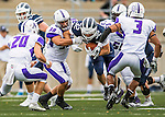 8 October 2016: Middlebury College Panther Running Back Drew Jacobs, a Junior from Marblehead, MA, breaks away from Amherst College Offensive Linebacker Andrew Yamin, a Sophomore from Cheshire, CT, as he rushes for yardage against the Amherst College Purple & White at Alumni Stadium in Middlebury, Vermont. The Panthers edged out the Purple & While 27-26. Mandatory Credit: Ed Wolfstein Photo *** RAW (NEF) Image File Available ***