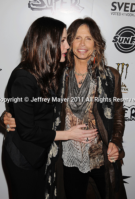 """HOLLYWOOD, CA - MARCH 21: Liv Tyler and Steven Tyler attend the """"Super"""" Los Angeles Premiere at the Egyptian Theatre on March 21, 2011 in Hollywood, California."""