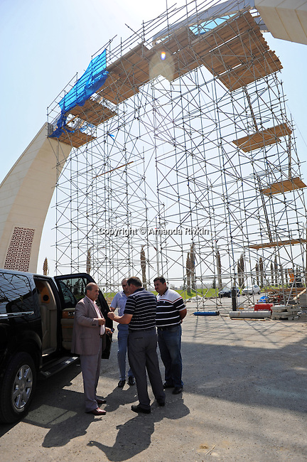 (At left) Ibrahim Ibrahimov, an Azerbaijani oligarch and billionaire, is seen underneath the entrance of the of the Khazar Islands project near Sahil, Azerbaijan on July 18, 2012.  The brainchild of Ibrahimov, the artificial Khazar Islands project just southwest of the Azerbaijani capital Baku is being built at a projected cost of $100 billion with an anticipated 800,000 housing units.
