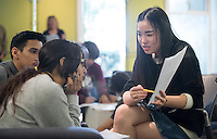Lyra Yu '18 and other Oxy students tutor logic to Los Angeles River School high school students in the MLK Lounge of Pauley Hall, March 17, 2016 as part of professor Carolyn Brighouse's class.<br />