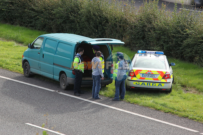 Garda from Drogheda stop a vehicle on the M1 under the Slane interchange..Photo: Fran Caffrey/www.newsfile.ie..