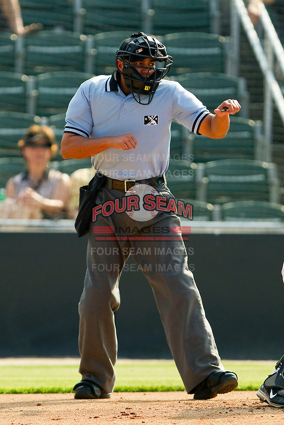 Home plate umpire Roberto Ortiz calls a batter out on strikes during the South Atlantic League game between the Delmarva Shorebirds and the Kannapolis Intimidators at Fieldcrest Cannon Stadium on May 22, 2011 in Kannapolis, North Carolina.   Photo by Brian Westerholt / Four Seam Images