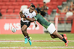 Jerry Tuwai of Fiji runs with the ball during the match Fiji vs South Africa, Day 2 of the HSBC Singapore Rugby Sevens as part of the World Rugby HSBC World Rugby Sevens Series 2016-17 at the National Stadium on 16 April 2017 in Singapore. Photo by Victor Fraile / Power Sport Images