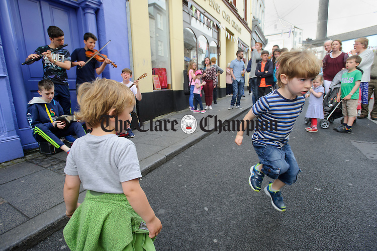 A youngster dances on O Connell street, Ennis during Fleadh Cheoil na hEireann. Photograph by John Kelly.