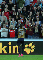 Joel Campbell of Arsenal (R) celebrates his goal during the Barclays Premier League match between Swansea City and Arsenal at the Liberty Stadium, Swansea on October 31st 2015