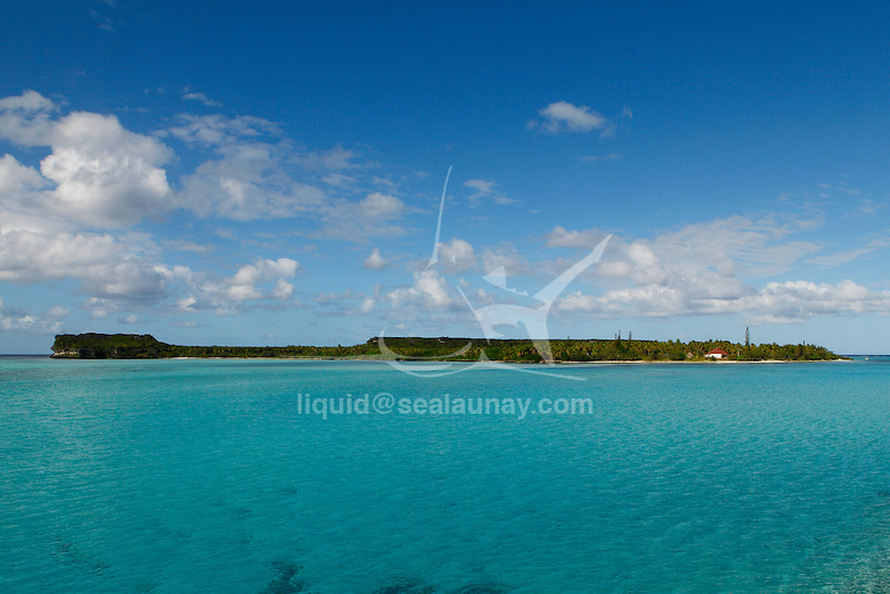 """View of  Lakini from the Mouli Bridge on the Ouvea island in the Loyalty islands..Ouvéa (local pronunciation: [u?ve.a]) is a commune in the Loyalty Islands Province of New Caledonia, an overseas territory of France in the Pacific Ocean. The settlement of Fayaoué [fa?jawe], on Ouvéa Island, is the administrative centre of the commune of Ouvéa..Ouvéa is made up of Ouvéa Island, the smaller Mouli Island and Faiava Island, and several islets around these three islands. All these lie among the Loyalty Islands, to the northeast of New Caledonia's mainland..Ouvéa Island is one of the Loyalty Islands, in the archipelago of New Caledonia, an overseas territory of France in the Pacific Ocean. The island is part of the commune (municipality) of Ouvéa, in the Islands Province of New Caledonia..The crescent-shaped island, which belongs to a larger atoll, is 50 km (30 miles) long and 7 km (4.5 miles) wide. It lies northeast of Grande Terre, New Caledonia's mainland..Ouvéa is home to around 3,000 people that are organized into tribes divided into Polenesian, Melanesian and Walisian by ethnic descend. The Iaai language is spoken on the island..The two native languages of Ouvéa are the Melanesian Iaai and the Polynesian Faga Uvea, which is the only Polynesian language that has taken root in New Caledonia. Speakers of Faga Uvea have fully integrated into the Kanak society, and consider themselves Kanak..Ouvéa has rich marine resources and is home to many sea turtles, species of fish, coral as well as a native parrot, the Uvea Parakeet, that can only be found on the island of Ouvéa..A large crustacaen called a """"coconut crab"""" or crabe de cocotier can also be found on the islands. The large crabs live in palm tree plantations and live solely on a diet of coconuts that they crack open with their powerful claws. They are blue in colour and can grow to several kilos in size. They are a land based species and do not venture into the ocean.."""