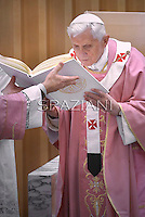 "Pope Benedict XVI as he leads a mass during his visit to the parish church ""Santa Maria delle Grazie"" in Rome on December 11, 2011."
