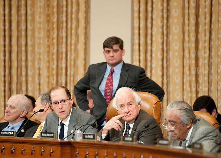"UNITED STATES – FEBRUARY 3: Chairman Dave Camp, R-Mich., left, and ranking member Sander Levin, D-Mich., listen to the proceedings during The House Ways and Means Committee mark up hearing of H.R. 3865, the ""American Energy and Infrastructure Jobs Financing Act of 2012,"" on Friday, Feb. 3, 2012. (Photo by Bill Clark/CQ Roll Call)"