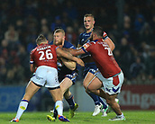 7th September 2017, Beaumont Legal Stadium, Wakefield, England; Betfred Super League, Super 8s; Wakefield Trinity versus St Helens; Luke Thompson of St Helens is stopped by Chris Annakin of Wakefield Trinity and David Fifita of Wakefield Trinity