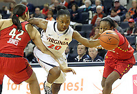 Virginia guard Faith Randolph (20) drives thru Maryland center Brionna Jones (42) and Maryland guard Shatori Walker-Kimbrough (32) during the game Thursday in Charlottesville, VA. Virginia defeated Maryland 86-72. Photo/The Daily Progress/Andrew Shurtleff
