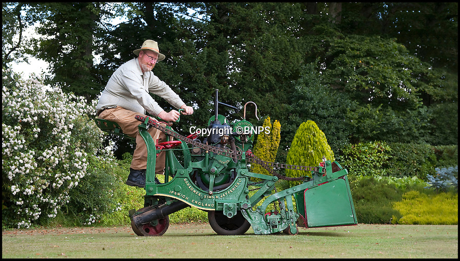 BNPS.co.uk (01202 558833)<br /> Pic: PhilYeomans/BNPS.co.uk<br /> <br /> Lawnmowing history...<br /> <br /> One man went to mow.<br /> <br /> The worlds first powered mower has taken to the grass once more after an exhaustive restoration by lawnmower nut Andrew Hall from Somerset.<br /> <br /> Forerunner of all the machines that have graced British lawns on sunday afternoons through the decades since, This 1902 Ransome 3hp is a historic survivor from the Edwardian age when chauffers were given the task of grooming their masters lawns and the new fangled machines cost as much as a house.<br /> <br /> The 1 1/4 ton leviathan cost &pound;137 in 1903 - equivalent to a whopping &pound;15,000 in todays money. In consequence they were only available to the very rich, but aristocratic one upmanship lead to a rapid 'lawnmower arms race' untill the first war intervened.<br /> <br /> Although the first machine it still boasts many of the features still common a century later, 42inch blade, heavy roller, tiller steering, a huge grass box that could be emptied from the driver seat and adjustable blade height. Brakes however were a later innovation so much skill was required to pilot the huge contraptions.