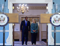 January 11, 2012  (Washington, DC)  U.S. Secretary of State Hillary Rodham Clinton and Qatari Foreign Minister Sheikh Hamad bin Jassim bin Jabor Al Thani enter the Treaty Room at the State Department in Washington after a bilateral meeting.  (Photo by Don Baxter/Media Images International)