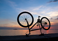 Bikes along Manila Bay at sunset, Philippines