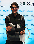 BANGKOK, THAILAND - SEPTEMBER 30:  Rafael Nadal of Spain smiles before a meeting with Thailand's Prime Minister Abhisit Vejjajiva during the PTT Thailand Open at Impact Arena on September 30, 2010 in Bangkok, Thailand. Photo by Victor Fraile / The Power of Sport Images